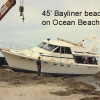 Bayliner 45 Washed up on Oceanside Beach